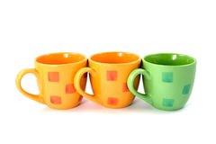 Three colorful coffee cups Stock Photo