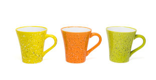 Three colorful coffee cups isolated on white background stock image