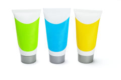Three colorful cosmetic tubes Stock Photo