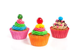 Three colorful creamed cupcakes Stock Photo