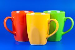 Three colorful cups Royalty Free Stock Photos
