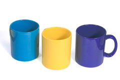 Three colorful cups. Three multicolored tea cups isolated on a white background Royalty Free Stock Photography