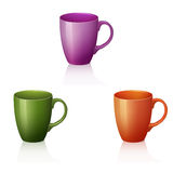Three colorful cups with reflection and shadow Stock Images