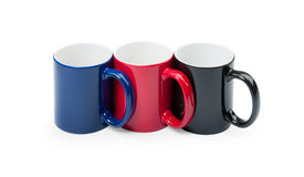 Three colorful cups in a row Royalty Free Stock Image