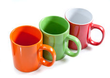 Three colorful cups Stock Images