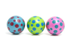 Three colorful dotted balls Stock Images