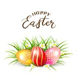 Easter eggs in grass with flowers. Three colorful Easter eggs in grass with flowers. Lettering Happy Easter, illustration Royalty Free Stock Photography