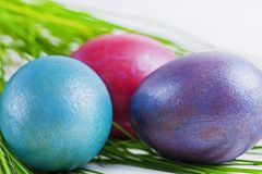 Three colorful Easter eggs on a white background Stock Photo