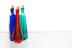 Three colorful empty bottles on white background Royalty Free Stock Photos