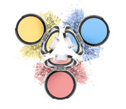 Three colorful eyeshadow cosmetic products Stock Image