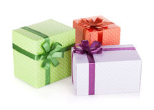 Three colorful gift boxes with ribbon and bow Royalty Free Stock Photos