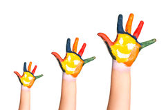 Three colorful hands with smiling face  Royalty Free Stock Photo