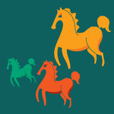 Three colorful horses on a green background Stock Image