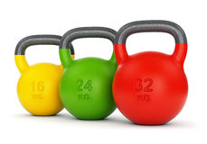 Three colorful kettlebells Royalty Free Stock Photos