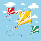 Three colorful kites in the blue sky Stock Images