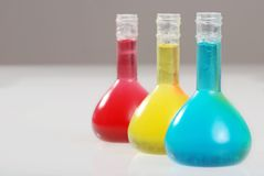 Three colorful laboratory flasks Stock Photos