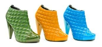 Three colorful leather stylish shoes isolated Royalty Free Stock Photo