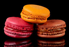 Three colorful macarons on black background Royalty Free Stock Photography