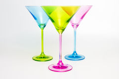 Three colorful martini glasses. Isolated on white Royalty Free Stock Photo