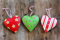 Three colorful metal hearts Stock Image