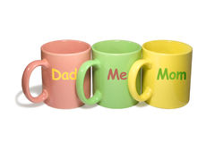 Three colorful mugs -  Dad, Me, Mom (family) Royalty Free Stock Images