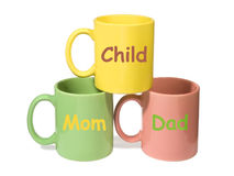 Three colorful mugs - Mom, Dad, Child (family) Stock Photo