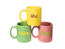 Three colorful mugs - Mom, Dad, Me (family) Royalty Free Stock Photography