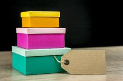 Three colorful nesting gift boxes and tag royalty free stock image