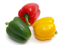 Three colorful paprikas Stock Photography
