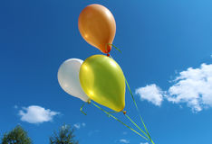 Three colorful party balloons Stock Photography