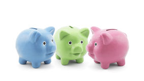 Three colorful piggy banks Stock Photo