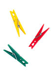Three colorful plastic clothespins Royalty Free Stock Photography