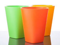 Three colorful plastic cups on white. 