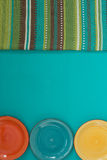 Three colorful plates and striped cloth Royalty Free Stock Image