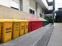 Three colorful recycling and garbage bins in Thailand. Text on the Yellow bin said Dry Garbage Text on the Red bin said Hazard Gar. Garbage bins in Thailand Stock Photos
