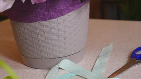 Three colorful ribbon rolls on white table stock video footage