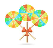 Three colorful, round, isolated lollipops with red Royalty Free Stock Photography