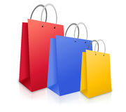 Three Colorful Shopping Bags. (red, blue and yellow) are standing upright on a white isolated background Royalty Free Stock Images