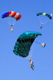 Three Colorful Skydiving Base Jumpers Floating. Three base jumpers each with a very colorful parachutes floating down after leaping from the New River Gorge Royalty Free Stock Photo