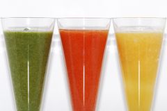 Three colorful smoothie partial view Stock Photo
