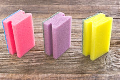 Three colorful sponges Stock Images