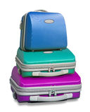 Three colorful suitcases. Piled on top of each other islolated on a white background with clipping path supplied Stock Images