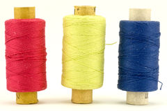 Three colorful thread spools Royalty Free Stock Image