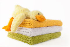 Free Three Colorful Towels With Yellow Plush Duck Stock Photography - 74245832