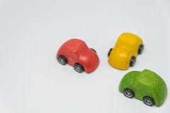 Three colorful toy car parked intersection with white background and selective focus Royalty Free Stock Image