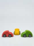 Three colorful toy car parked intersection with white background and selective focus Stock Photos