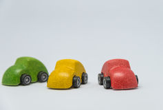 Three colorful toy car with white background and selective focus Royalty Free Stock Photography