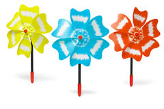Three colorful toy windmills Royalty Free Stock Photo