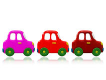 Three colorful toys cars. With reflection on white Stock Photos