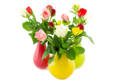 Three colorful vases filled with roses Stock Photography
